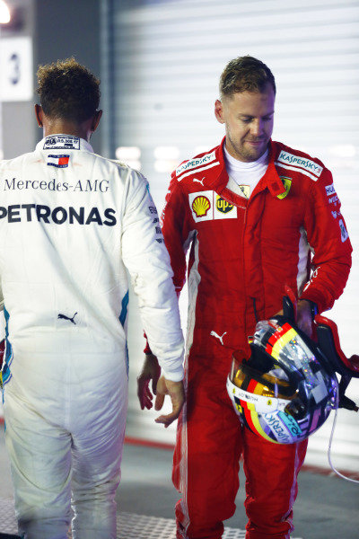 Lewis Hamilton, Mercedes AMG F1 W09 EQ Power+, and Sebastian Vettel, Ferrari SF71H, in Parc Ferme at the end of the race
