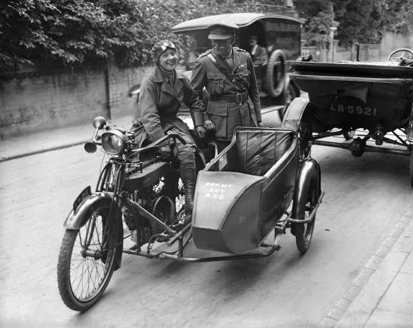 A motorcycle sidecar rider and an officer at the Army Service Corps Motor Transport Depot in Isleworth.