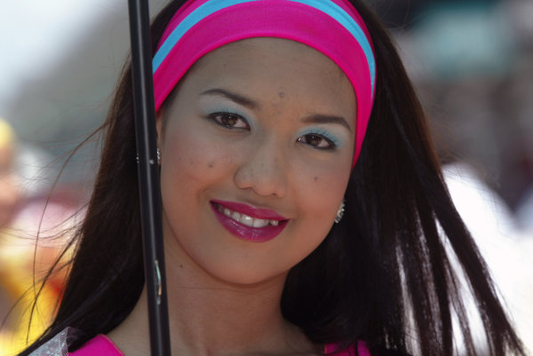 2003 Malaysian Grand Prix. Sepang, Kuala Lumpur, Malaysia.21-23 March 2003.A Malaysian grid girl.World Copyright - Steve Etherington/LAT Photographic ref: Digital Image Only