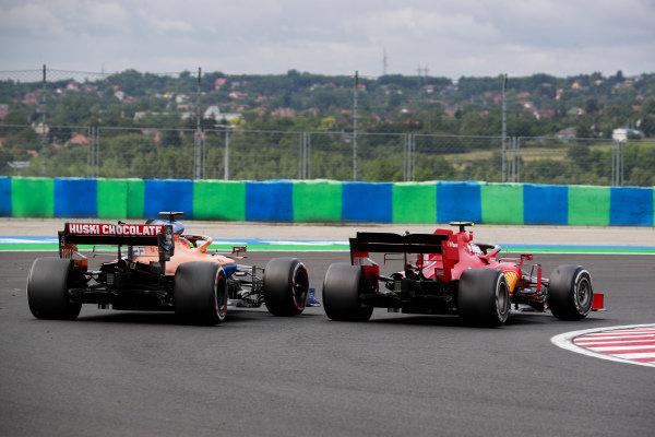 Carlos Sainz, McLaren MCL35 and Charles Leclerc, Ferrari SF1000