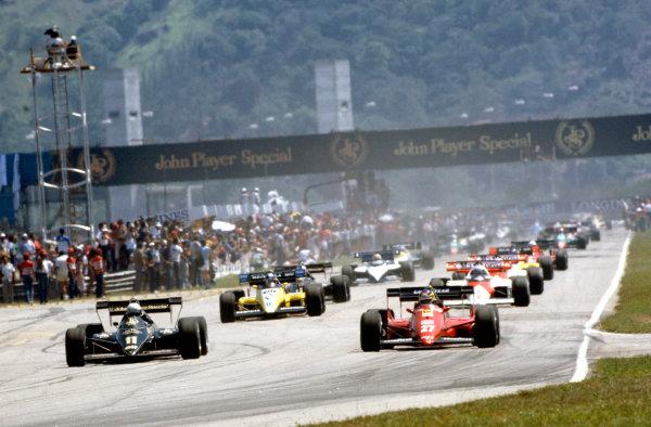 Jacarepagua, Rio de Janeiro, Brazil.23-25 March 1984.Michele Alboreto (Ferrari 126C4), retired leads Elio de Angelis (Lotus 95T Renault), 3rd position, at the start of the formation lap, action.Ref-84 BRA 25.World Copyright - LAT Photographic