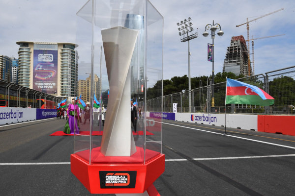 The trophy is presented on the grid