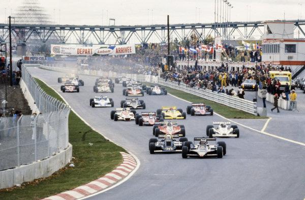 Pole sitter Jean-Pierre Jarier, Lotus 79 Ford leads Jody Scheckter, Wolf WR5 Ford, Gilles Villeneuve, Ferrari 312T3 and Alan Jones, Williams FW06 Ford.