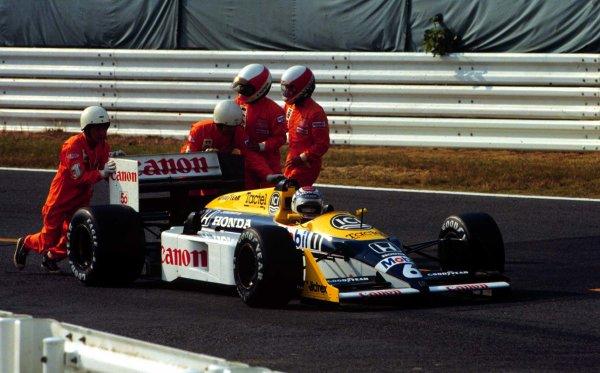 1987 Japanese Grand Prix.Suzuka, Japan.29/10-1/11 1987.Despite retiring from the race Nelson Piquet (Williams FW11 Honda) clinches the World Championship.World Copyright - LAT Photographic