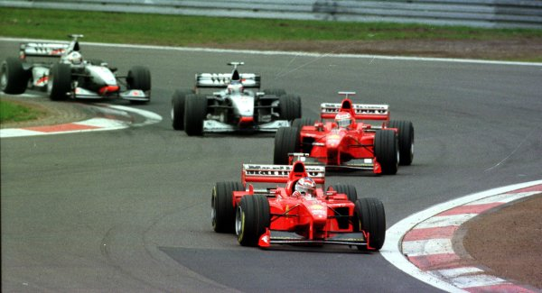 1998 Luxembourg Grand PrixNurburgring, Germany. 25-27 September 1998.Michael Schumacher leads Eddie Irvine (both Ferrari F300), Mika Hakkinen and David Coulthard (both McLaren MP4/13 Mercedes-Benz) at the start. Hakkinen finished in 1st position.World Copyright - Steve Etherington/LAT Photographic