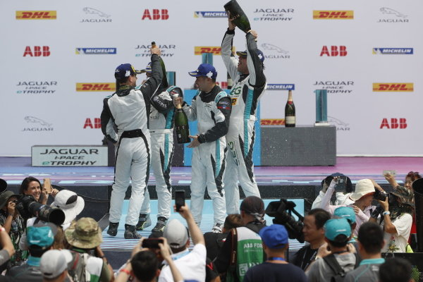 Bryan Sellers (USA), Rahal Letterman Lanigan Racing, Yaqi Zhang (CHI), Team China, and Cacá Bueno (BRA), Jaguar Brazil Racing, celebrate on the podium