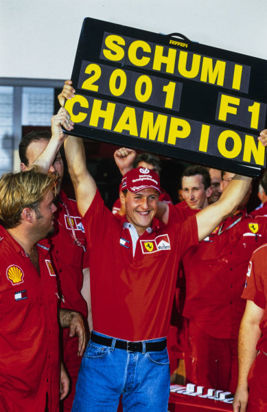 Michael Schumacher celebrates his fourth world drivers' championship with the Ferrari team.
