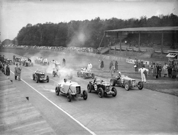 The cars pull away at the start of one of the day's races.