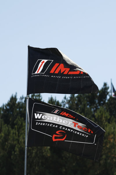 Imsa and WeatherTech flags fly alogside the trance during the Petit LeMans at Michelin Raceway Road Atlanta 2020