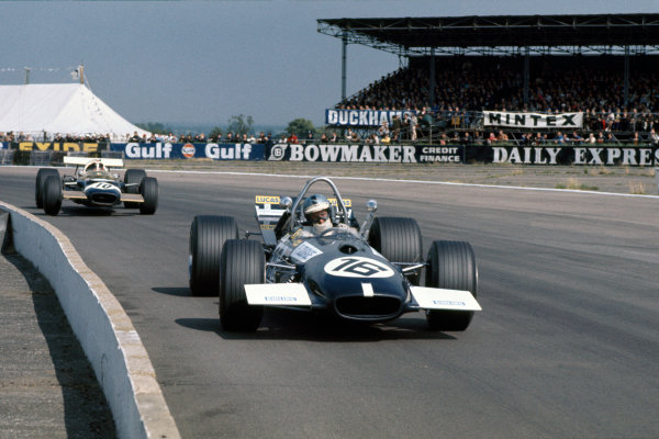 Silverstone, Great Britain. 19th July 1969.Piers Courage (Brabham BT26-Ford), 5th position, leads Jo Siffert (Lotus 49B-Ford), 8th position, action.World Copyright: LAT Photographic.Ref: 69 GB 46.