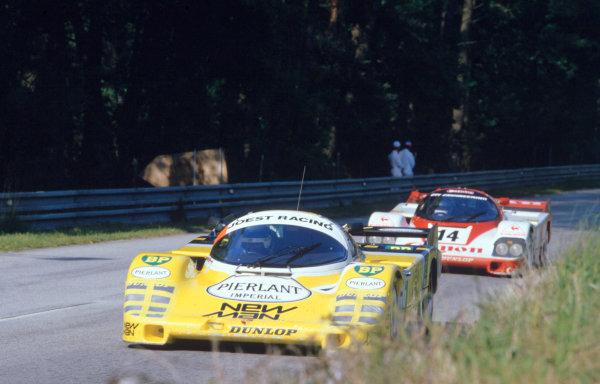 1984 Le Mans 24 hours. Le Mans, France. 16-17 June1984. Klaus Ludwig/Henri Pescarolo (Porsche 956), 1st position, leads Jonathan Palmer/Jan Lammers (Porsche 956)action. World Copyright: LAT Photographic. Ref: 84LM17.