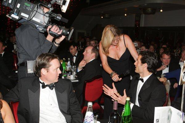 2005 Autosport AwardsGrosvenor House, London. 4th December.Mark Webber answers Louise Goodman's question as Sam Michael looks on.World Copyright: Glenn Dunbar/LAT Photographicref: Digital Image Only
