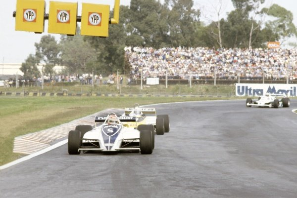 1981 Argentinian Grand Prix.Buenos Aires, Argentina. 10-12 April 1981.Nelson Piquet (Brabham BT49C-Ford Cosworth), 1st position, leads Alain Prost (Renault RE20), 3rd position, and Alan Jones (Williams FW07C-Ford Cosworth), 4th position.World Copyright: LAT PhotographicRef: 35mm transparency 81ARG04