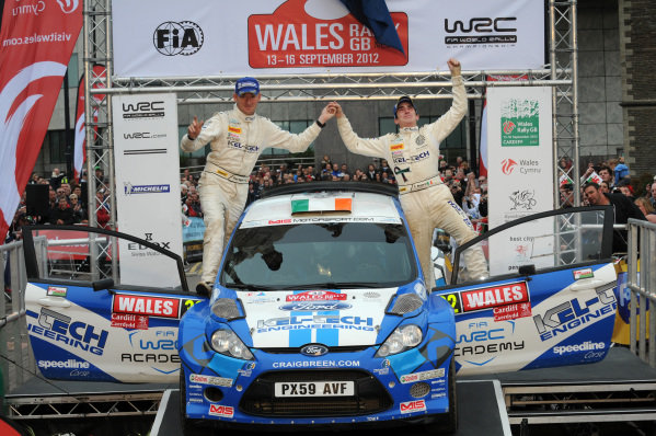 Craig Breen (IRL) and Paul Nagle (IRL), Ford Fista S2000 dedicates his win to Gareth Roberts (GBR) on the podium.
