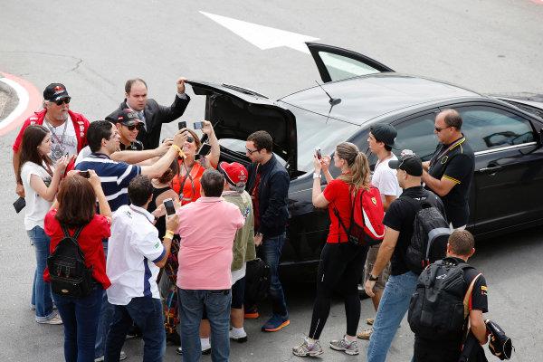 Interlagos, Sao Paulo, Brazil. Sunday 9 November 2014. Pastor Maldonado, Lotus F1, poses for photos with fans. World Copyright: Charles Coates/LAT Photographic. ref: Digital Image _J5R5426