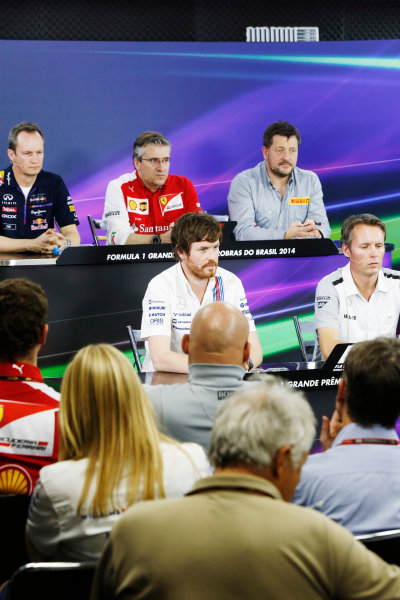 Interlagos, Sao Paulo, Brazil. Friday 7 November 2014. Jonathan Wheatley, Team Manager, Red Bull Racing, Pat Fry, Director of Chassis, Ferrari, Paul Hembrey, Director, Pirelli Motorsport, Rob Smedley, Head of Vehicle Performance, Williams F1, and Sam Michael, Sporting Director, McLaren, in the Team Principals Press Conference. World Copyright: Charles Coates/LAT Photographic. ref: Digital Image _N7T9443
