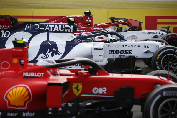 Sebastian Vettel, Ferrari SF1000, Pierre Gasly, AlphaTauri AT01, and Charles Leclerc, Ferrari SF1000, arrive in Parc Ferme