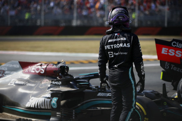 Sir Lewis Hamilton, Mercedes, walks away after crashing out of the race with Max Verstappen, Red Bull Racing