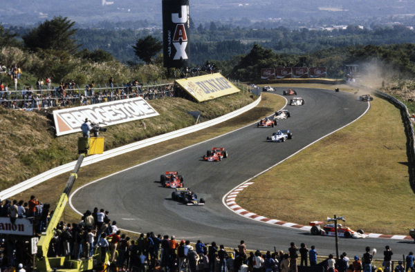 Jochen Mass, McLaren M26 Ford leads Clay Regazzoni, Ensign N177 Ford amd John Watson, Brabham BT45B Alfa Romeo as Mario Andretti, Lotus 78 Ford loses a tyre in a collision, putting him out of the race.