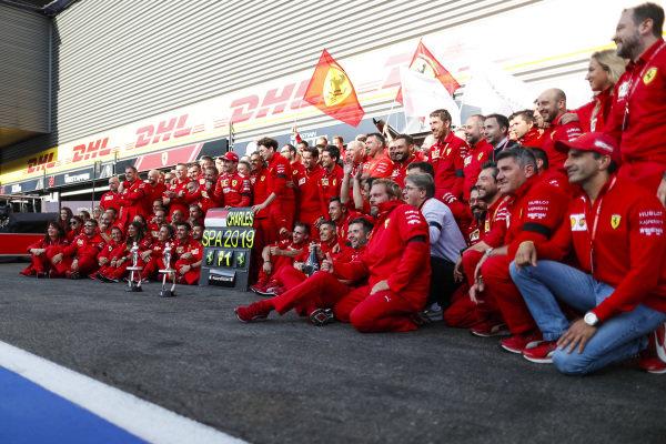 Charles Leclerc, Ferrari, celebrates victory with Mattia Binotto, Team Principal Ferrari, and other colleagues