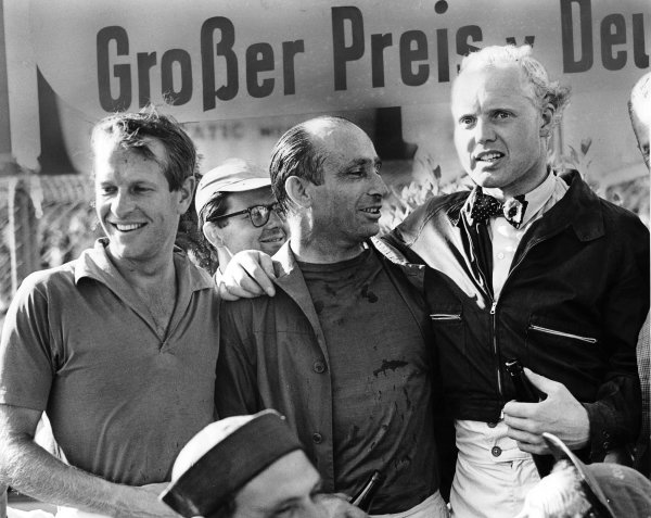1957 German Grand Prix. Nurburgring, Germany. 2-4 August 1957. Peter Collins (Ferrari) 3rd position, Juan Manuel Fangio (Maserati) 1st position and Mike Hawthorn (Ferrari) 2nd position on the podium. World Copyright - LAT Photographic