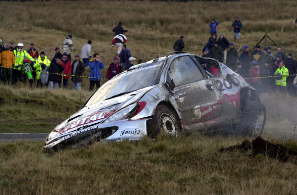2002 World Rally Championship.Network Q Rally of Great Britain, Cardiff. November 14-17. Marcus Gronholm's Peugeot after his big roll on Stage 10, Halfway, on day two.Photo: Ralph Hardwick/LAT