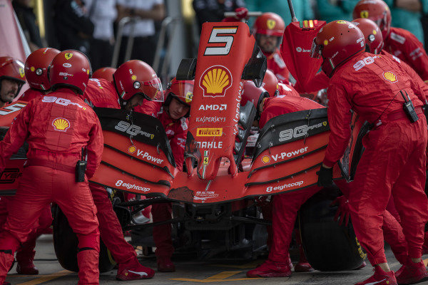 The damaged nose of Sebastian Vettel, Ferrari SF90 is removed after a collision on track
