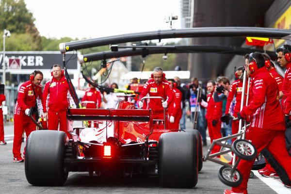 Kimi Raikkonen, Ferrari SF71H, makes a pit stop.