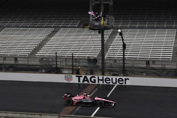 Jack Harvey, Meyer Shank Racing crosses the finish line under the checkered flag