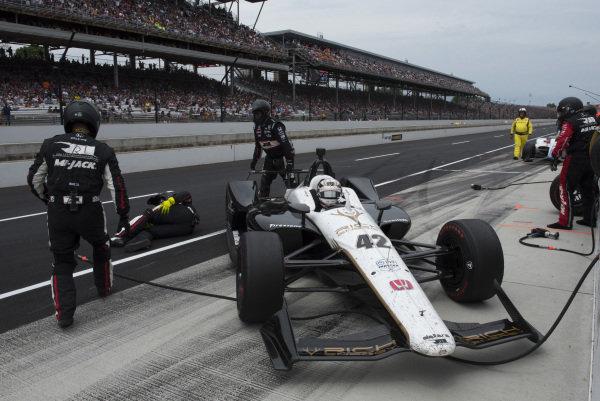 Jordan King, Rahal Letterman Lanigan Racing Honda, slides into pit box, striking tire, and injuring crewman