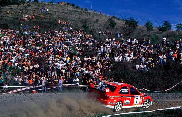 2001 World Rally Championship. Catalunya Rally, Spain. 22nd - 25th March 2001. Rd 4. Tommi Makinen / Mannisenmaki, Mitsubishi Lancer Evo, action. World Copyright: McKlein / LAT Photographic. Ref: A06