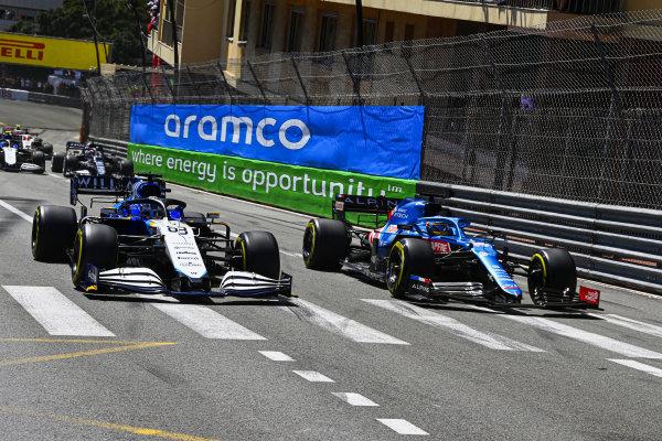 Fernando Alonso, Alpine A521, battles with George Russell, Williams FW43B
