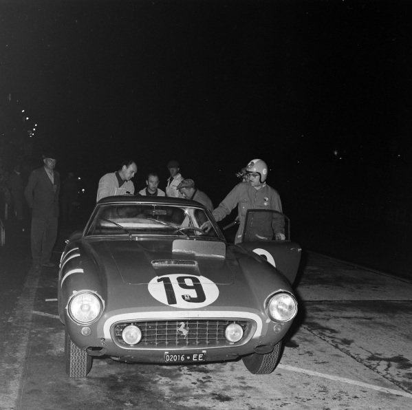 Ed Hugus / Augie Pabst, North American Racing Team, Ferrari 250 GT SWB, makes a pitstop.