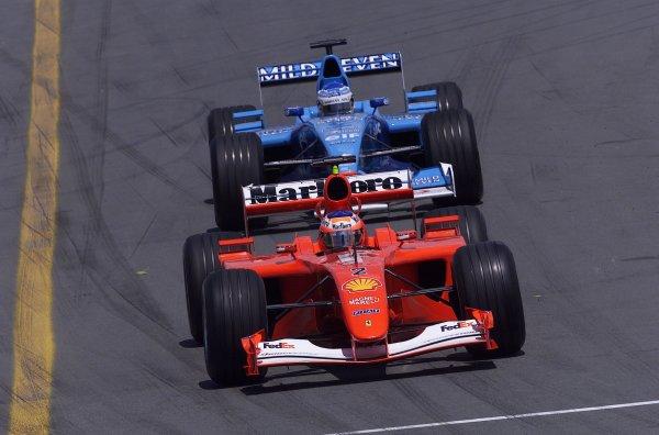 2001 Canadian Grand Prix - RACEMontreal, Canada. 10th June 2001.Rubens Barrichello (Ferrari) leads Jenson Button (Benetton-Renault).World Copyright - LAT PhotographicRef: 8 9 MB Digital File Only