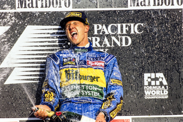 Michael Schumacher, 1st position, sprays the celebratory champagne on the podium.