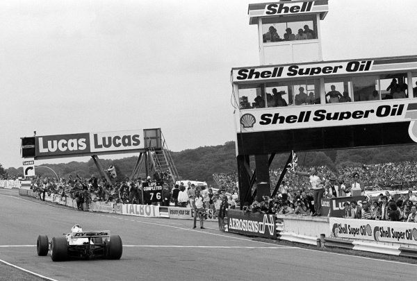 Race winner Alan Jones (AUS) Williams FW07B takes the chequered flag at the end of the race. Formula One World Championship, Rd8, British Grand Prix, Brands Hatch, England, 13 July 1980.