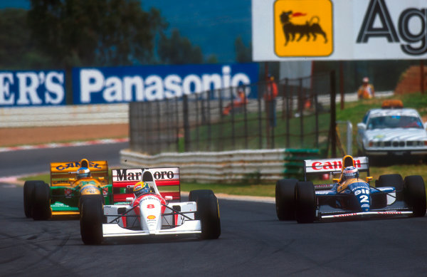 1993 South African Grand Prix.Kyalami, South Africa.12-14 March 1993.Ayrton Senna (McLaren MP4/8 Ford) leads Alain Prost (Williams FW15C Renault) and Michael Schumacher (Benetton B192B Ford). Ref-93 SA 07.World Copyright - LAT Photographic