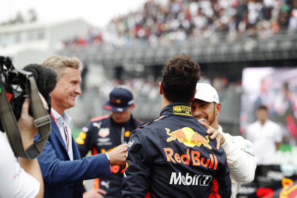 Lewis Hamilton, Mercedes AMG F1, congratulates Daniel Ricciardo, Red Bull Racing, as he talks to Presenter David Coulthard on the grid after taking Pole Position
