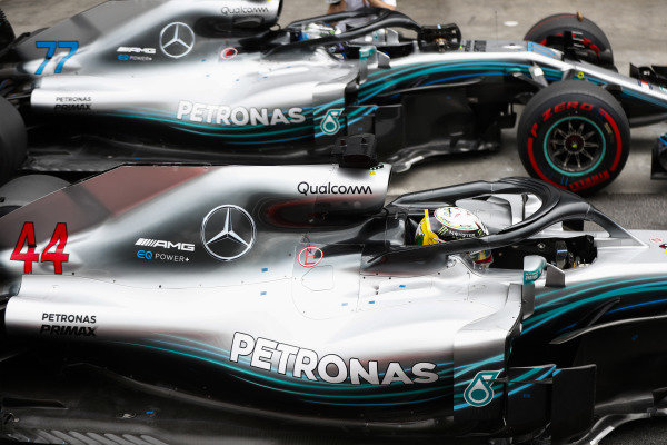 Lewis Hamilton, Mercedes AMG F1, celebrates pole position  in parc ferme alongside Valtteri Bottas, Mercedes AMG F1 W09.