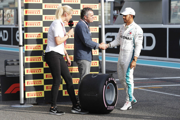 Lewis Hamilton, Mercedes AMG F1, is presented with the Pirelli Pole Position award