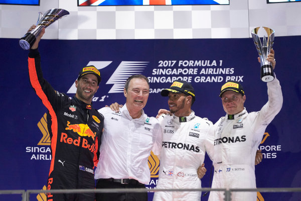 Marina Bay Circuit, Marina Bay, Singapore. Sunday 17 September 2017. Daniel Ricciardo, Red Bull Racing, 2nd Position, Lewis Hamilton, Mercedes AMG, 1st Position, and Valtteri Bottas, Mercedes AMG, 3rd Position, on the podium. World Copyright: Steve Etherington/LAT Images  ref: Digital Image SNE17359