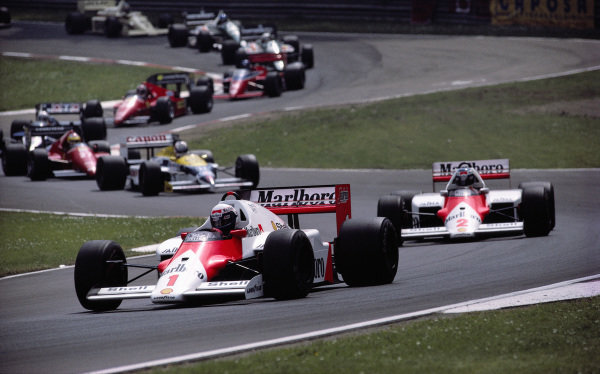 Alain Prost, McLaren MP4-2C TAG, leads teammate Keke Rosberg, Nigel Mansell, Williams FW11 Honda, and Michele Alboreto, Ferrari F1/86.