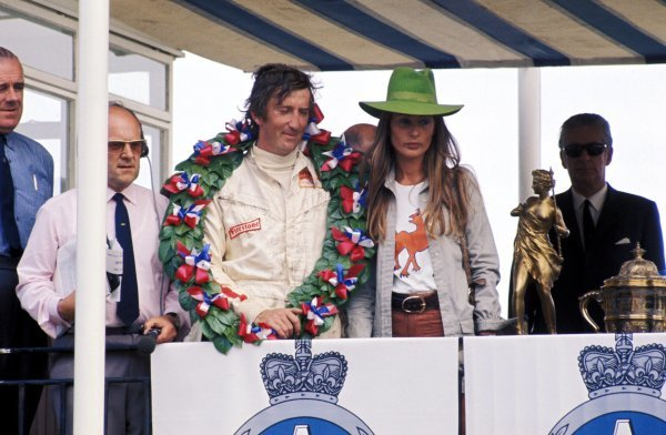 (L to R): Jochen Rindt (AUT) Lotus celebrates a hat trick of victories on the podium with his wife Nina Rindt (AUT). British Grand Prix, Brands Hatch, 18 July 1970. BEST IMAGE