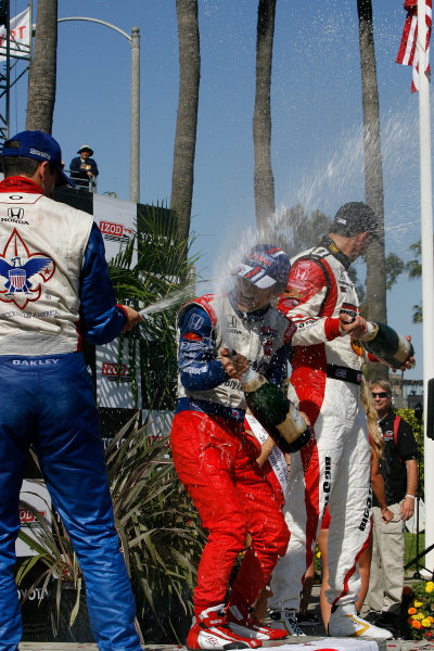 19-21 April 2013, Long Beach, California USA Justin Wilson, Takuma Sato, Graham Rahal with champagne.(c)2013, Todd Davis LAT Photo USA