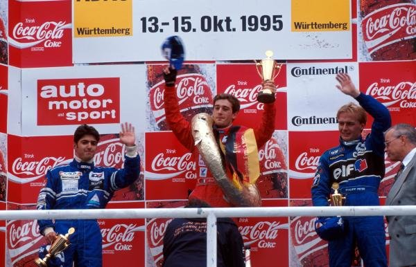 The podium for the final race of the season (l to r): Rui Aguas (POR) second; Jarno Trulli (ITA) winner; Philipp Peter (AUT) third.