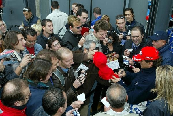 Alex Zanardi (ITA) BMW signs autographs for the fans. The Italian returned to racing for the first time after losing both legs in a horrific accident at the Lausitzring.
