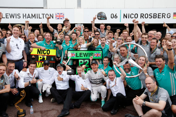 Monte Carlo, Monaco. Sunday 25 May 2014. Nico Rosberg, Mercedes AMG, 1st Position, Dr Dieter Zetsche, CEO, Mercedes Benz, Toto Wolff, Executive Director (Business), Mercedes AMG, Lewis Hamilton, Mercedes AMG, 2nd Position, and the Mercedes AMG team celebrate another victory. World Copyright: Charles Coates/LAT Photographic. ref: Digital Image _N7T0190