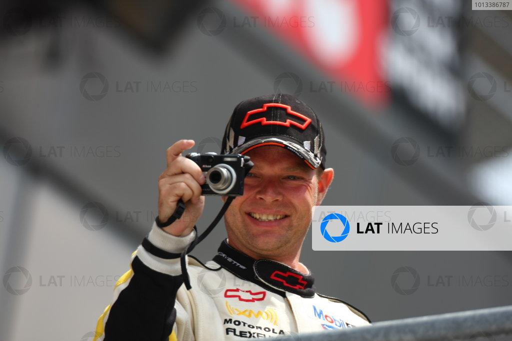 Circuit de La Sarthe, Le Mans, France.8th - 14th June 2009. Jan Magnussen, No 63 Corvette Racing Corvette C6 R, 1st in LMGT1 class, takes a picture from the podium. Portrait. Podium. World Copyright: Kevin Wood/LAT Photographic Photographic Ref: IMG_7205 JPG