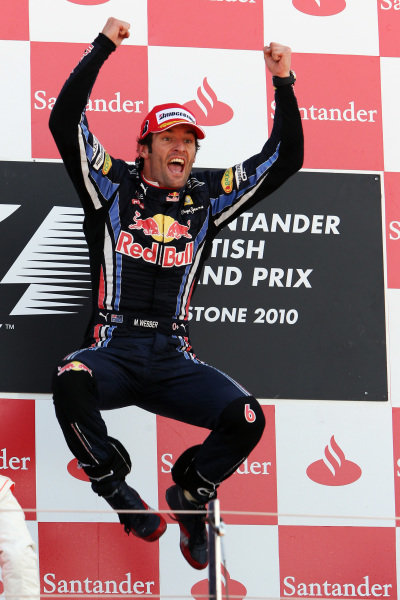 Race winner Mark Webber (AUS) Red Bull Racing celebrates on the podium.