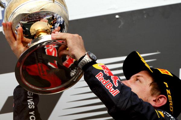 Bahrain International Circuit, Sakhir, Bahrain22nd April 2012Sebastian Vettel, Red Bull Racing, 1st position, celebrates on the podium.World Copyright: Andy Hone/LAT Photographicref: Digital Image HONY8655